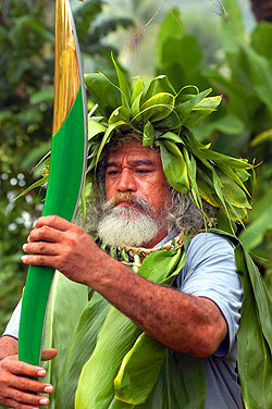 Nooroa Tupa. As the baton travels around Cook Islands' capital, Rarotonga, Nooroa Tupa, a speaker for Ngati Makea Tribe in Teauotonga Village inspects its unique shape and form.