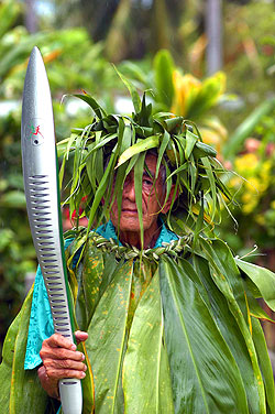 Sir Apenera Short. The Queen's Baton arrives in the Cook Islands, the 68th and third last country to host the baton before it arrives in Australia. Sir Apenera Short, a former Queen's representative is dressed in Teetree leaves, known as 'rauti'.