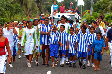 Aitutaki soccer team. The Aitutaki soccer team parades with the baton as the Melbourne 2006 Commonwealth Games Queen's Baton Relay continues in the Cook Islands.